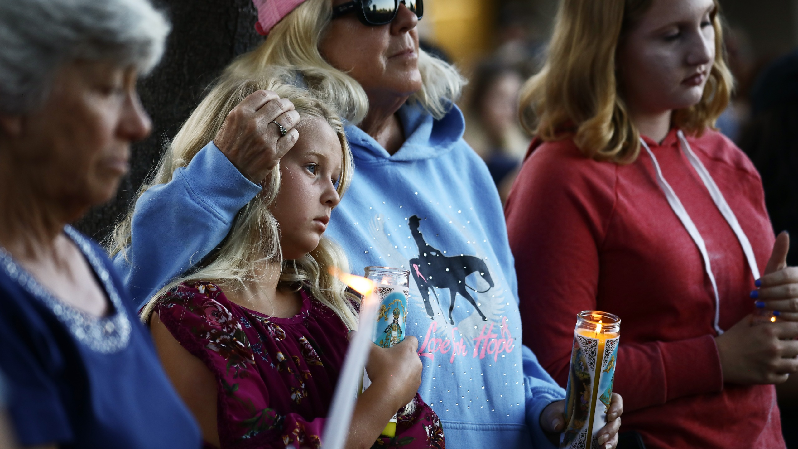 People attend a vigil in Gilroy for victims of the mass shooting at the garlic festival, July 29, 2019. (Credit: Mario Tama / Getty Images)