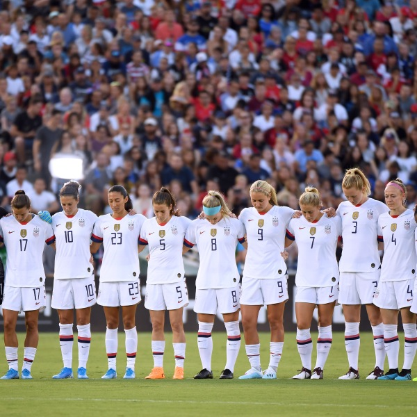 The United States women's soccer team stand for a moment of silence in honor of the victims in the El Paso, Texas shooting earlier today before the first game of the USWNT Victory Tour against the Republic of Ireland at Rose Bowl on August 03, 2019 in Pasadena, California. (Credit: Harry How/Getty Images)