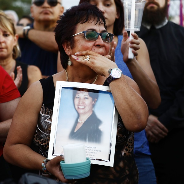 Lupe Lopez carries a photo of Elsa Mendoza Marquez, a Mexican schoolteacher from across the border in Ciudad Juarez who was killed in the shooting, during an interfaith vigil for victims of a mass shooting, which left at least 20 people dead, on Aug. 4, 2019 in El Paso, Texas. (Credit: Mario Tama/Getty Images)