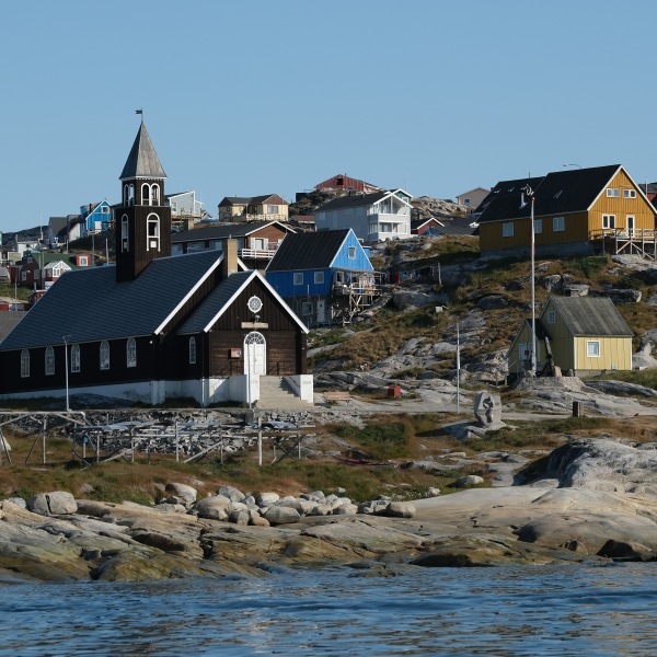 Zion Lutheran Church, built in 1779, stands on Disko Bay on August 04, 2019 in Ilulissat, Greenland. (Credit: Sean Gallup/Getty Images)