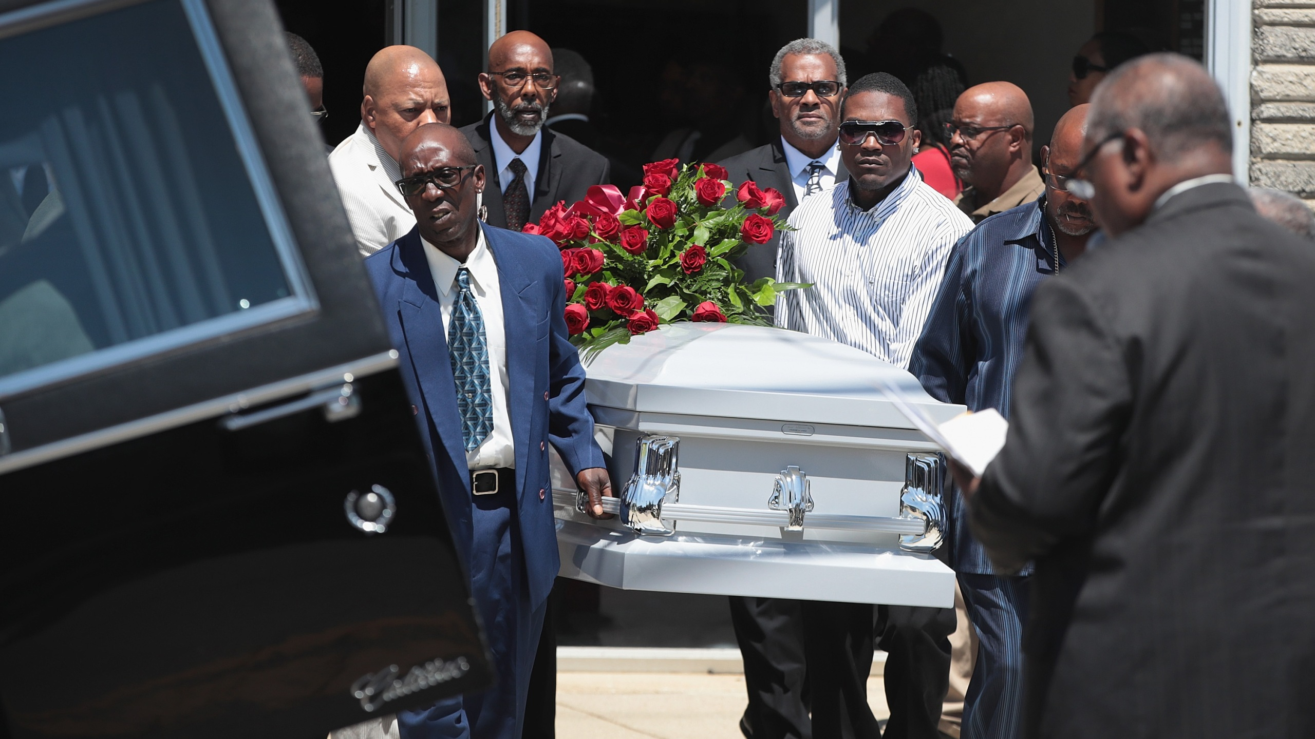 The remains of Derrick Fudge, 57, are placed in a hearse outside of St. John Missionary Baptist Church in Springfield, Ohio, following his funeral service on Aug. 10, 2019. Fudge was one of nine people killed when 24-year-old Connor Betts opened fire with a AR-15 style rifle in nearby Dayton.(Credit: Scott Olson / Getty Images)