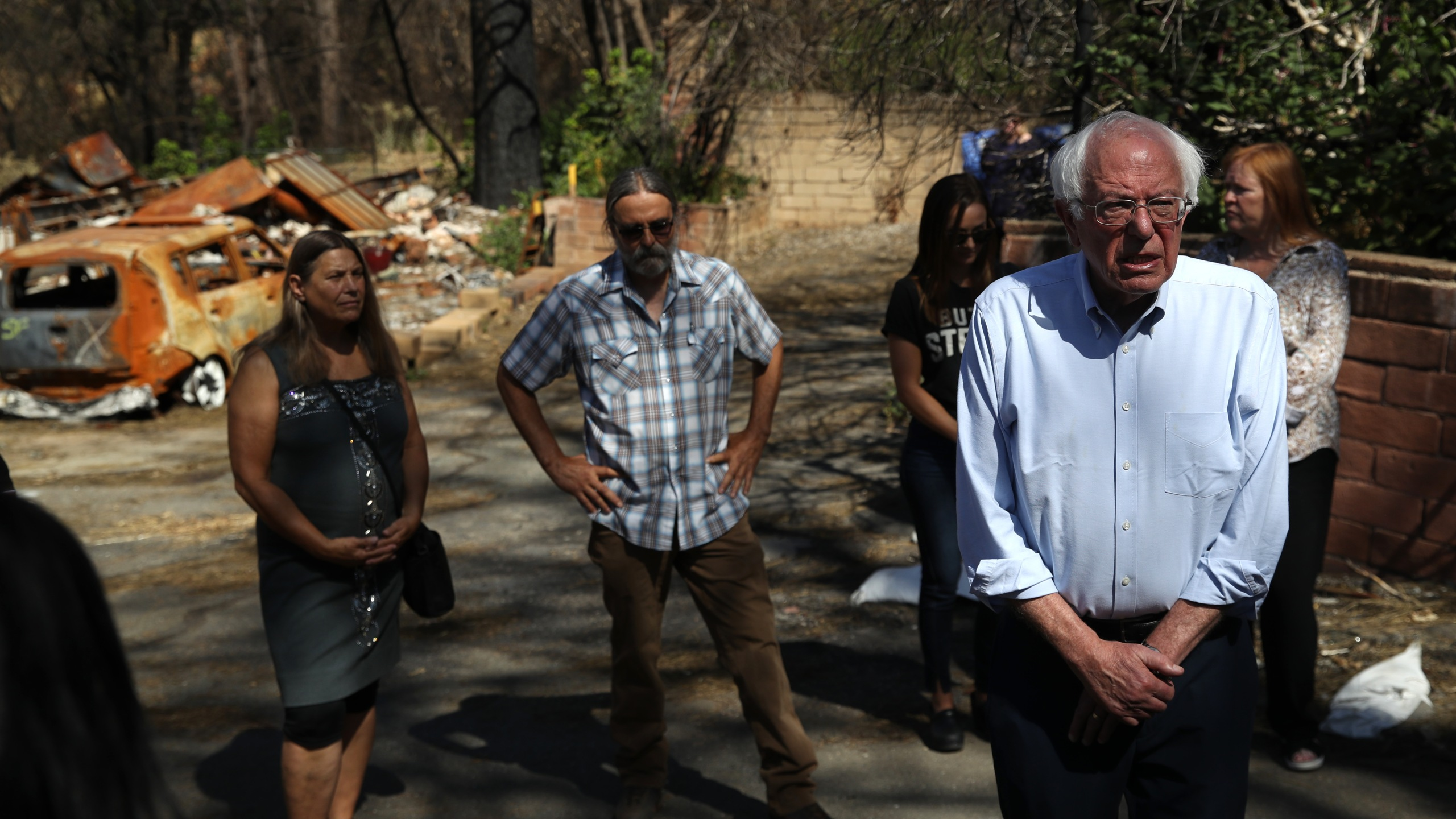 Democratic presidential candidate U.S. Sen. Bernie Sanders (I-VT) talks with members of the media as he tours a mobile home park that was destroyed by the Camp Fire on Aug. 22, 2019, in Paradise, Calif. (Credit: Justin Sullivan/Getty Images)