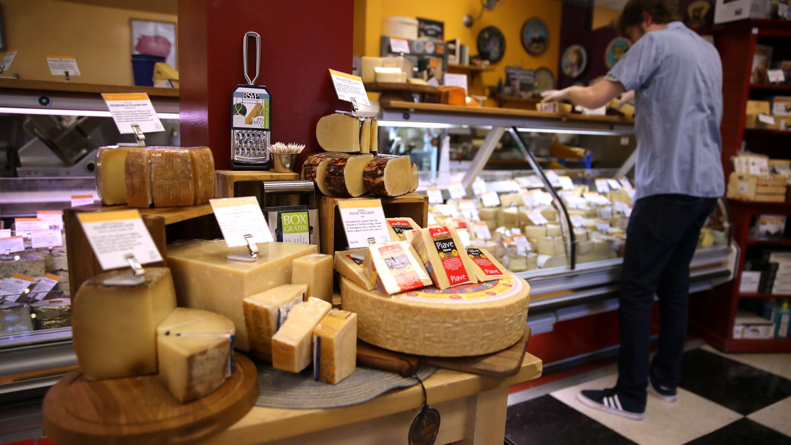 Imported parmesan cheese is displayed at Cheese Plus on Aug. 26, 2019, in San Francisco. The U.S. has proposed retaliatory tariffs on several European products including cheese, olive oil and wine that could be as much as 100 percent. The tariffs are in response to the European Union's subsidies to European aircraft manufacturer Airbus. (Credit: Justin Sullivan/Getty Images)