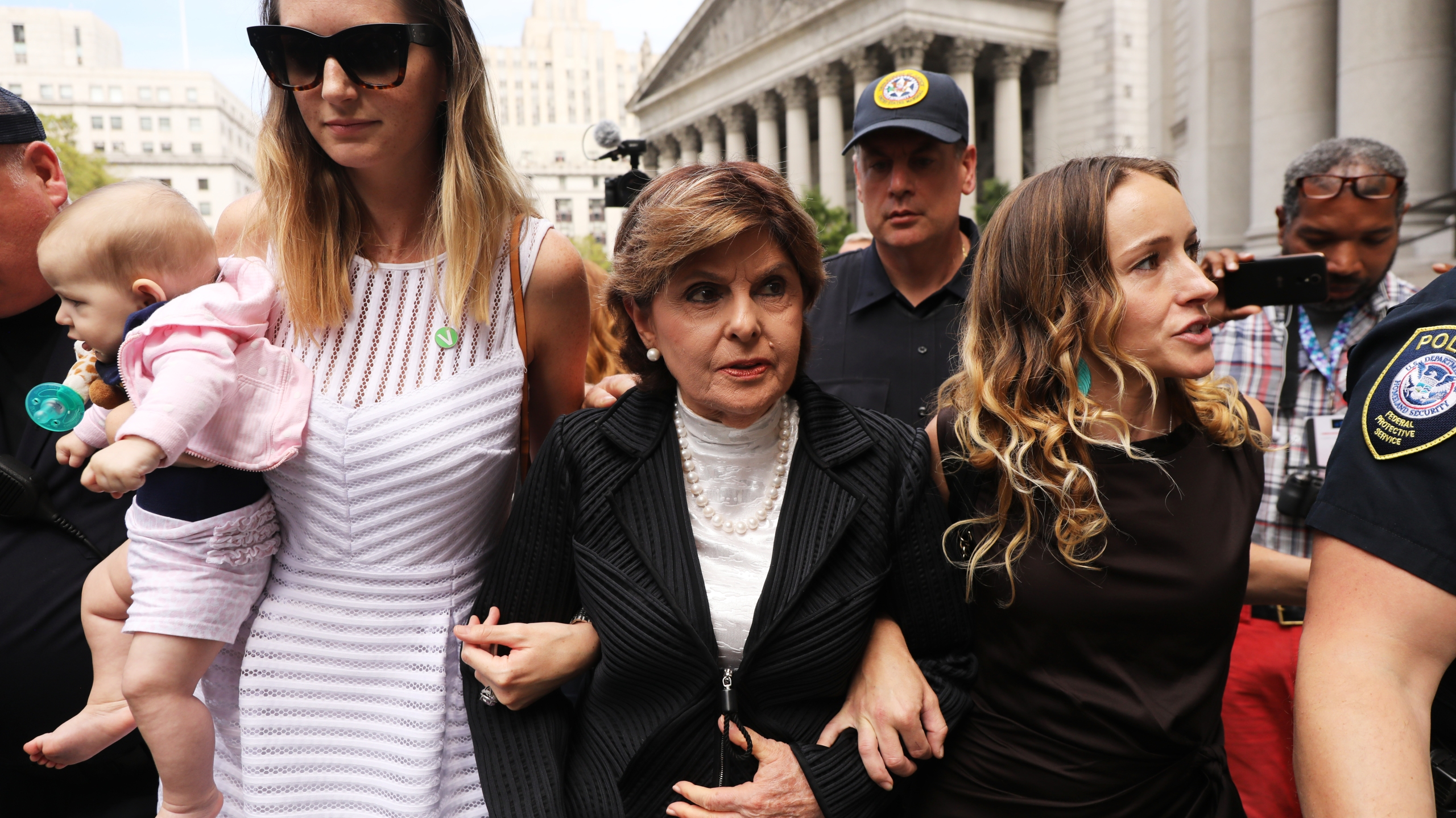 Attorney Gloria Allred, center, leaves a New York City courthouse on Aug. 27, 2019, with two women, a woman who did not wish to be identified, left, and Teala Davies, right, who have accused Jeffrey Epstein of sexually assaulting them. (Credit: Spencer Platt / Getty Images)