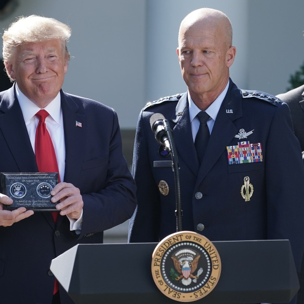 """From left: President Donald Trump, Air Force Gen. John """"Jay"""" Raymond and Defense Secretary Mark Esper attend an event marking the establishment the U.S. Space Command, the sixth national armed service, in the Rose Garden at the White House Aug. 29, 2019. (Credit: Chip Somodevilla / Getty Images)"""