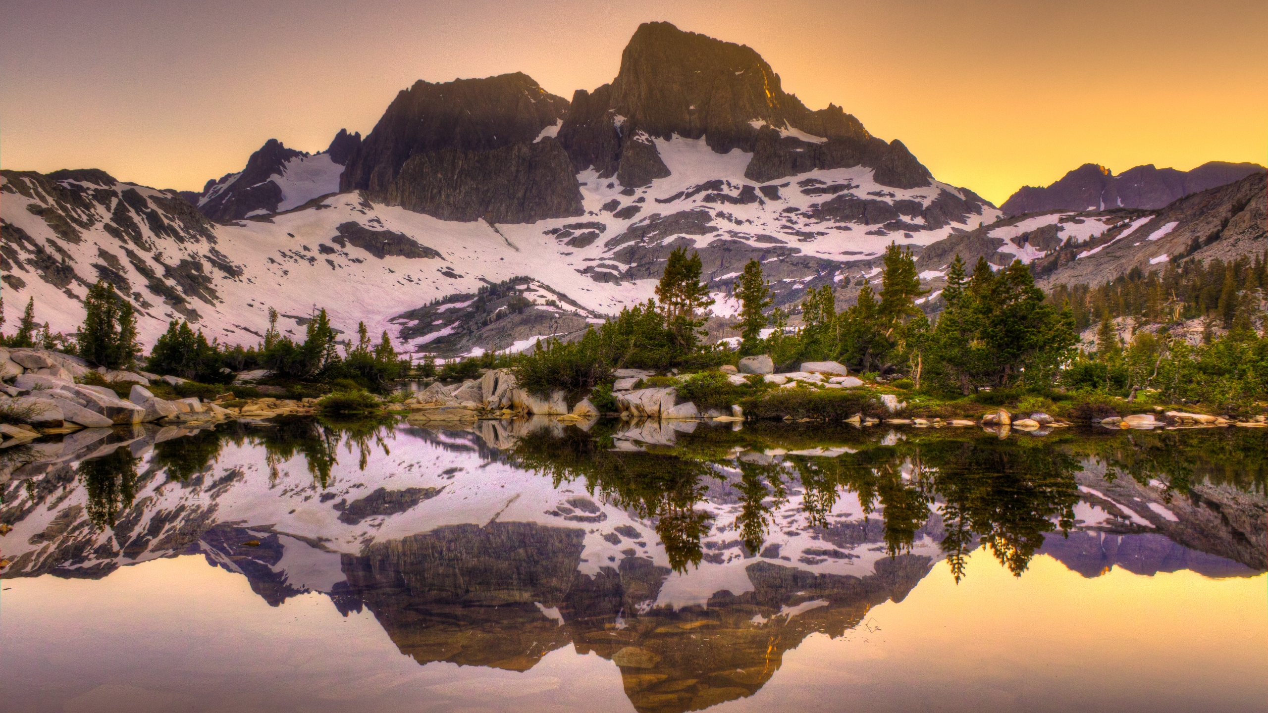Mount Banner and Mount Ritter are seen reflecting off Garnet Lake, about 2 1/2 miles north of Iceberg Lake, in a stock photo. (Credit: RMB Images / Photography by Robert Bowman via Getty Images)
