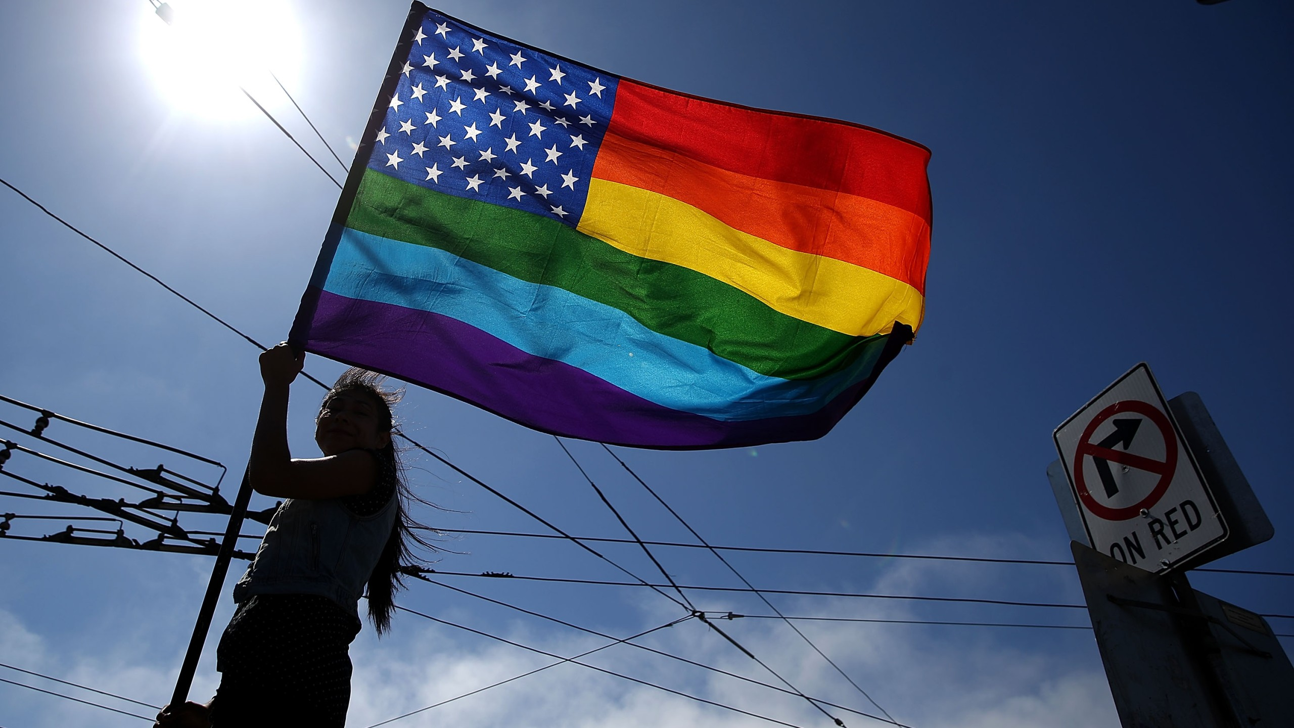A person waves a pride flag on June 26, 2015 in San Francisco. (Credit: Justin Sullivan/Getty Images)