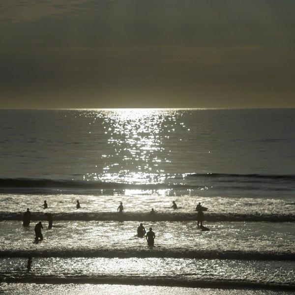 People swim in the Pacific Ocean off Del Mar beach Oct. 11, 2015, in La Jolla, Calif. (Credit: BRENDAN SMIALOWSKI/AFP/Getty Images)