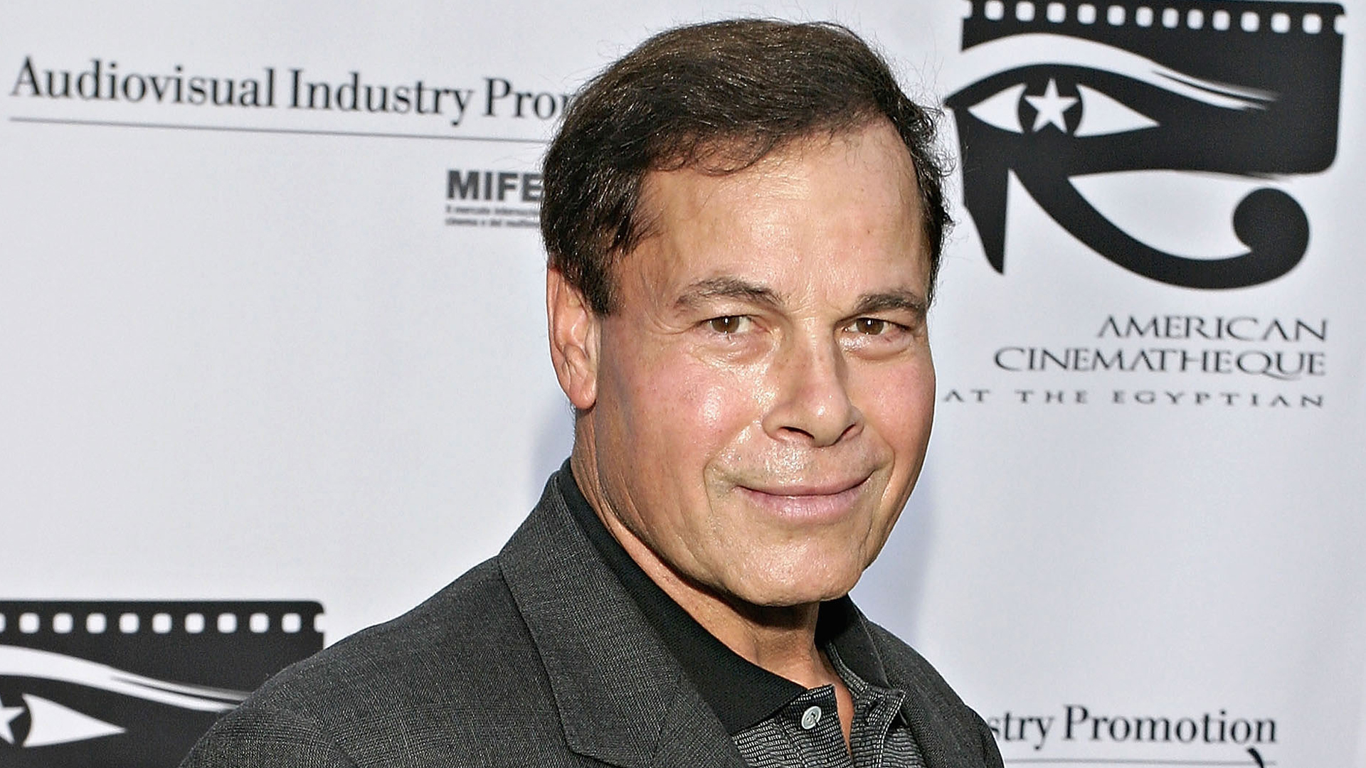 """Franco Columbu attends """"Cinema Italian Style: New Films From Italy (Under the Sign of Fellini)"""" on June 4, 2004 at the Egyptian Theatre in Hollywood. (Credit: Giulio Marcocchi/Getty Images)"""