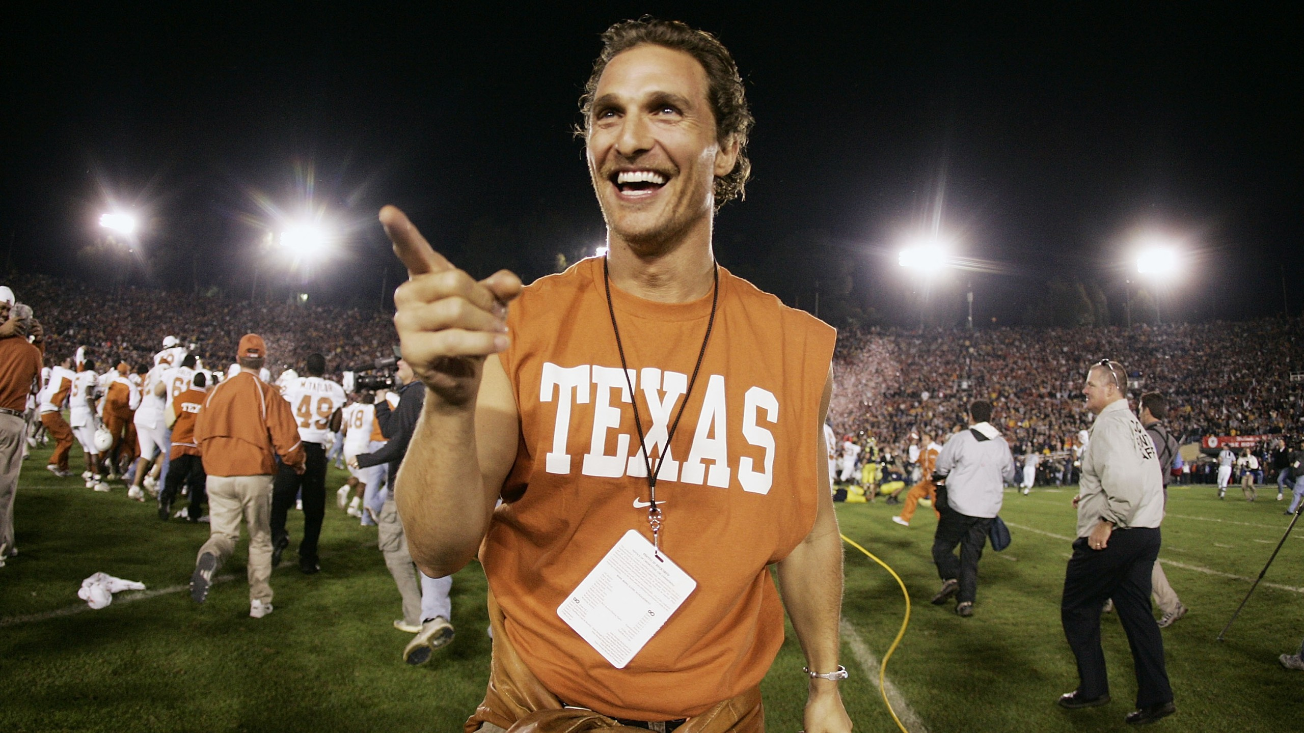 Actor Matthew McConaughey celebrates on the field after the Texas Longhorns defeated the Michigan Wolverines in the 91st Rose Bowl Game at the Rose Bowl on January 1, 2005 in Pasadena, California. (Credit: Donald Miralle/Getty Images)