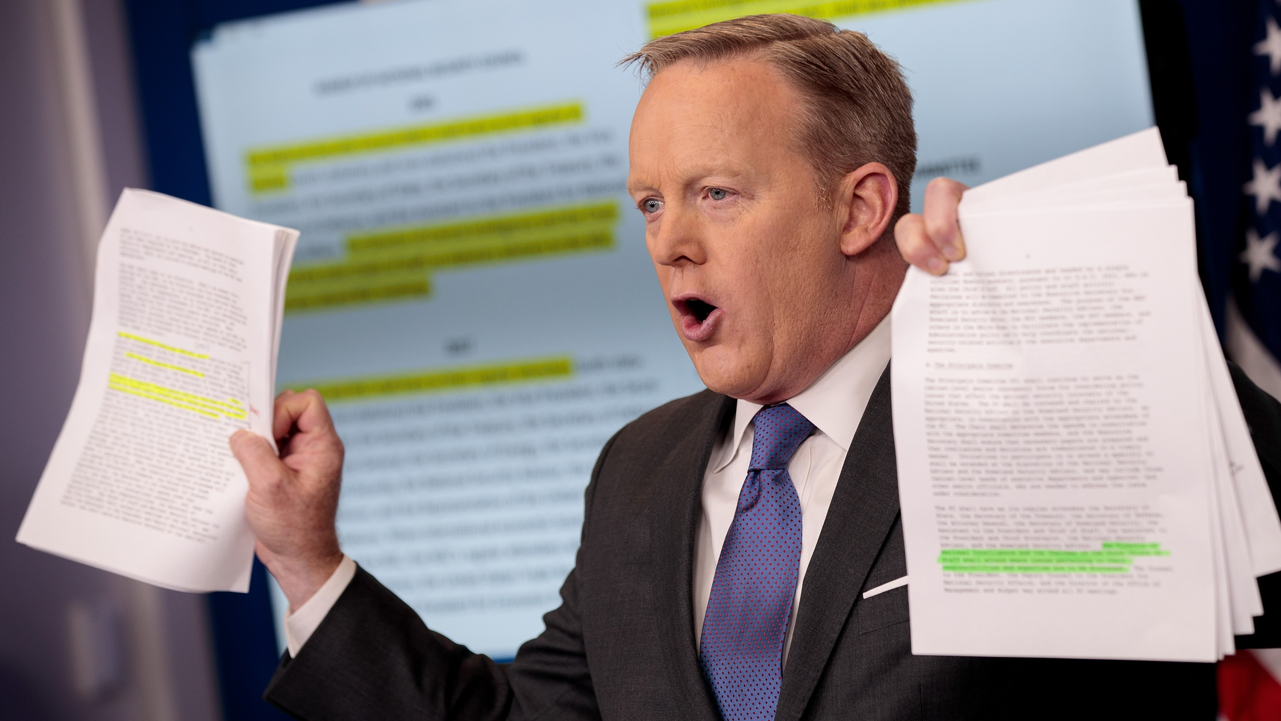 Sean Spicer holds up paperwork highlighting and comparing language about the National Security Council from the Trump administration and previous administrations during the daily press briefing at the White House, on Jan. 30, 2017 in Washington, D.C. (Credit: Drew Angerer/Getty Images)