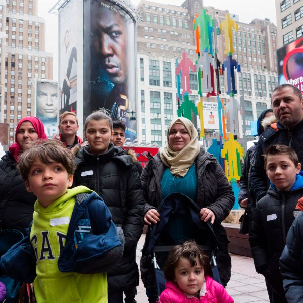 A group of Syrian and Iraqi refugee families gather outside Madison Square Garden for a tour of Manhattan on April 21, 2017, in New York City. (Credit: DON EMMERT/AFP/Getty Images)
