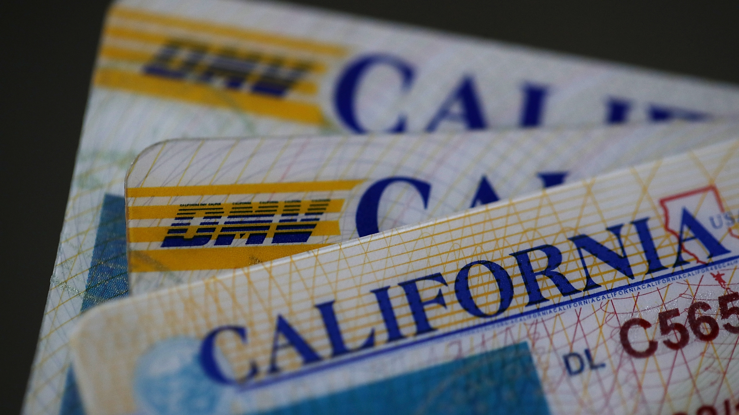 A stack of California Department of Motor Vehicles driver's licenses are seen on May 9, 2017, in San Anselmo, California. (Credit: Justin Sullivan/Getty Images)