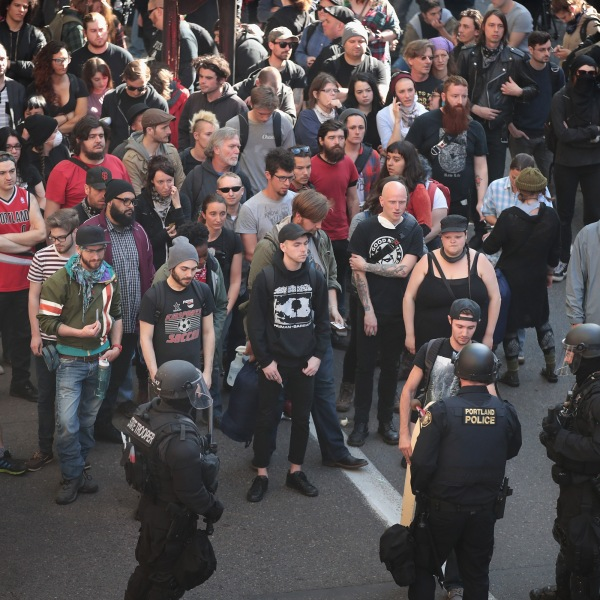 """Police detain hundreds of demonstrators """"on suspicion of disorderly conduct"""" during a protest on June 4, 2017 in Portland, Oregon. (Credit: Scott Olson/Getty Images)"""