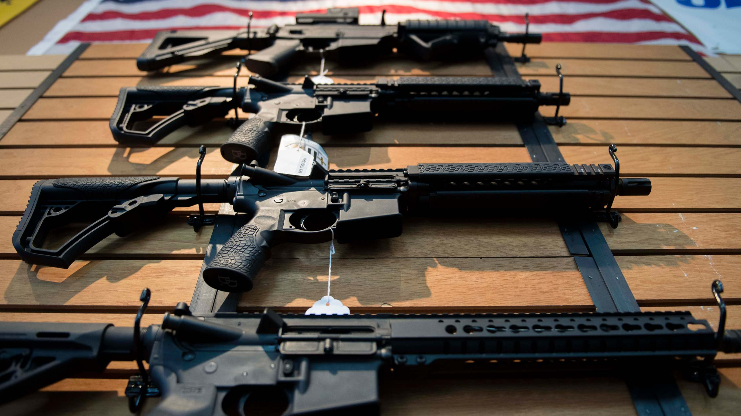 Assault rifles hang on the wall for sale at Blue Ridge Arsenal in Chantilly, Virginia, on Oct. 6, 2017. (Credit: Jim Watson / AFP / Getty Images)