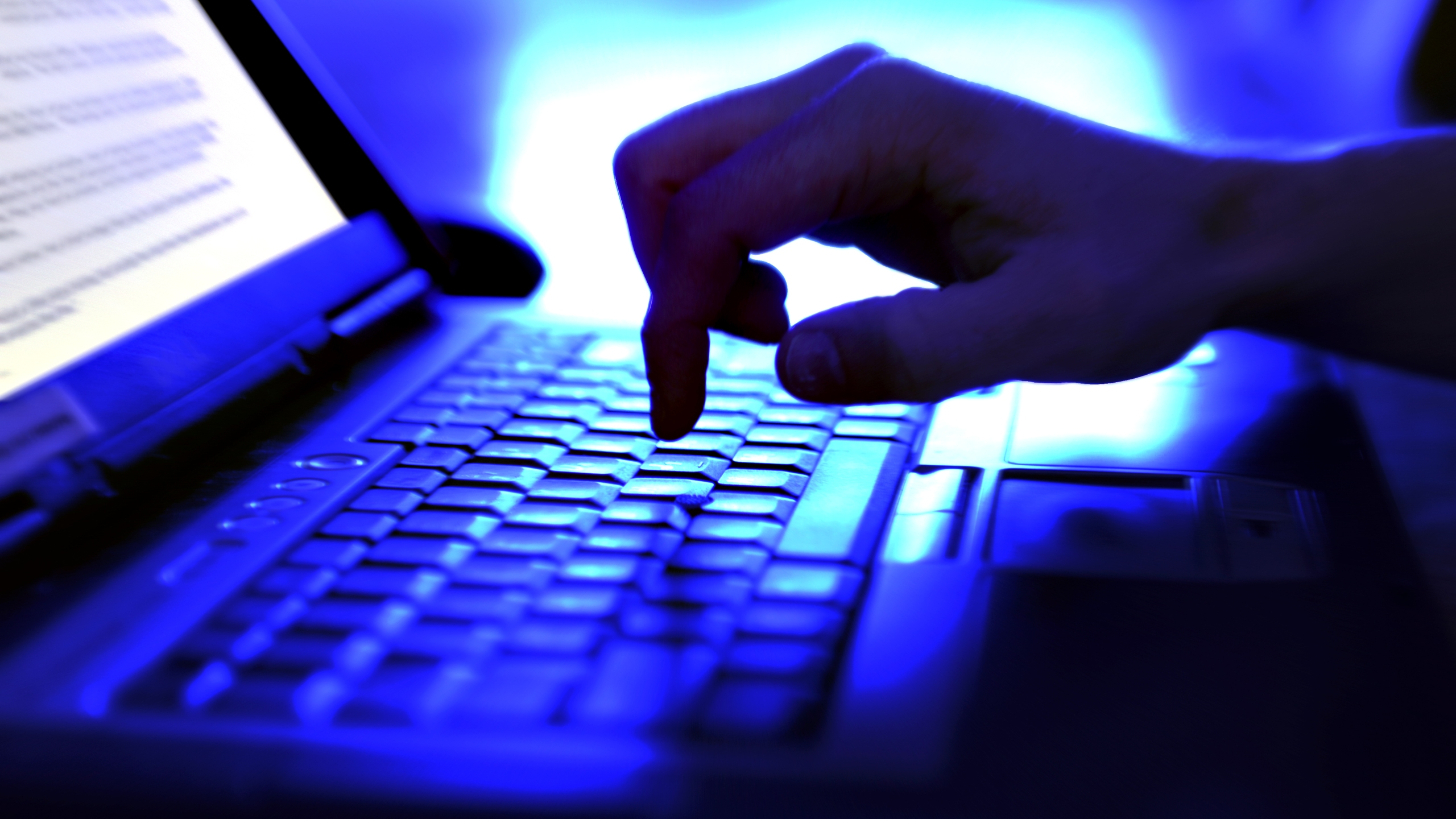 A person is seen typing on a computer. (Credit: Getty Images)