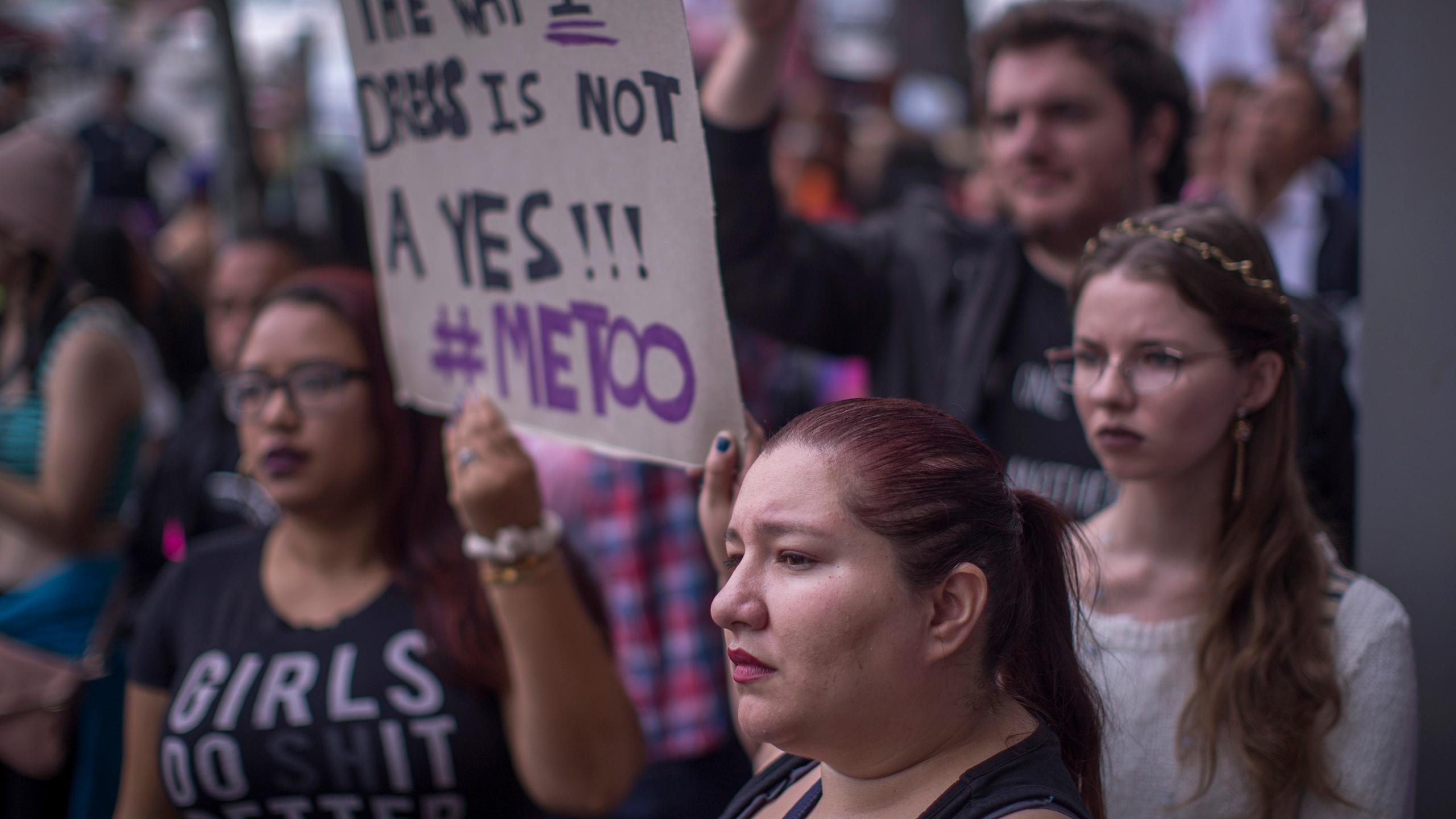 Demonstrators participate in the #MeToo Survivors' March outside the CNN building in response to several high-profile sexual harassment scandals on Nov. 12, 2017, in Los Angeles. (Credit: David McNew/Getty Images)