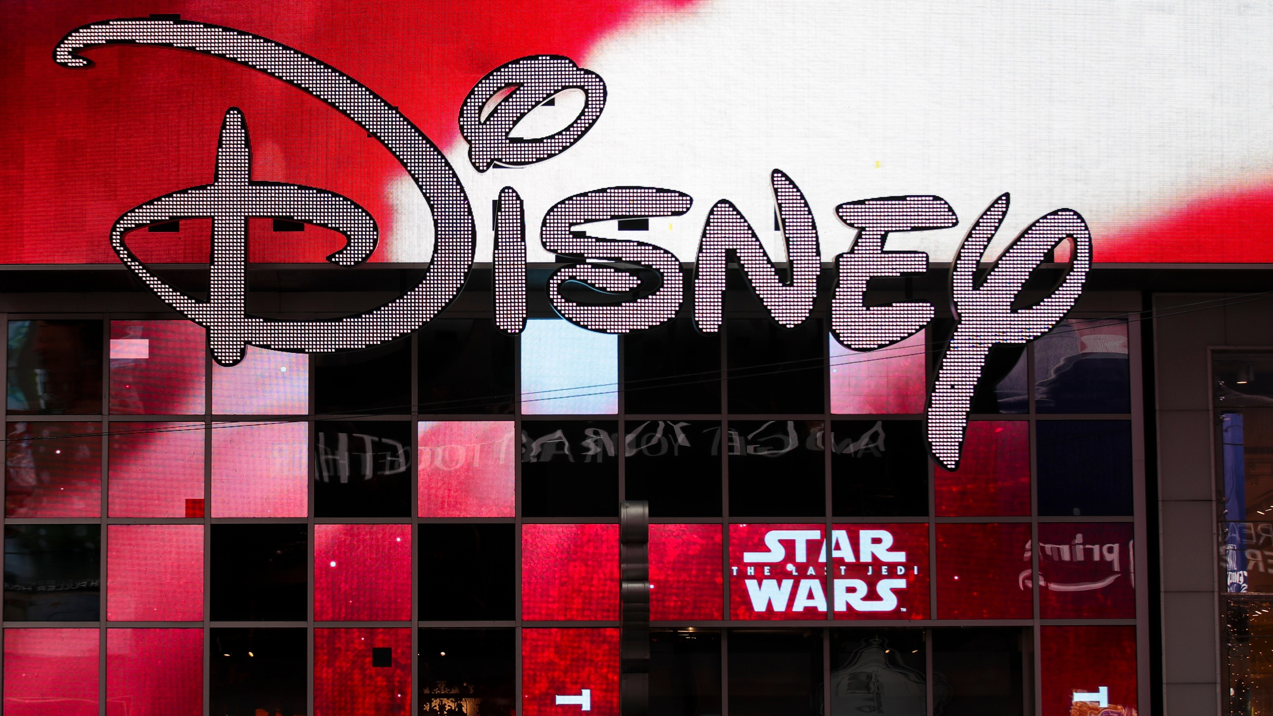 The Disney logo is displayed outside the Disney Store in Times Square on Dec. 14, 2017, in New York City. (Credit: Drew Angerer/Getty Images)
