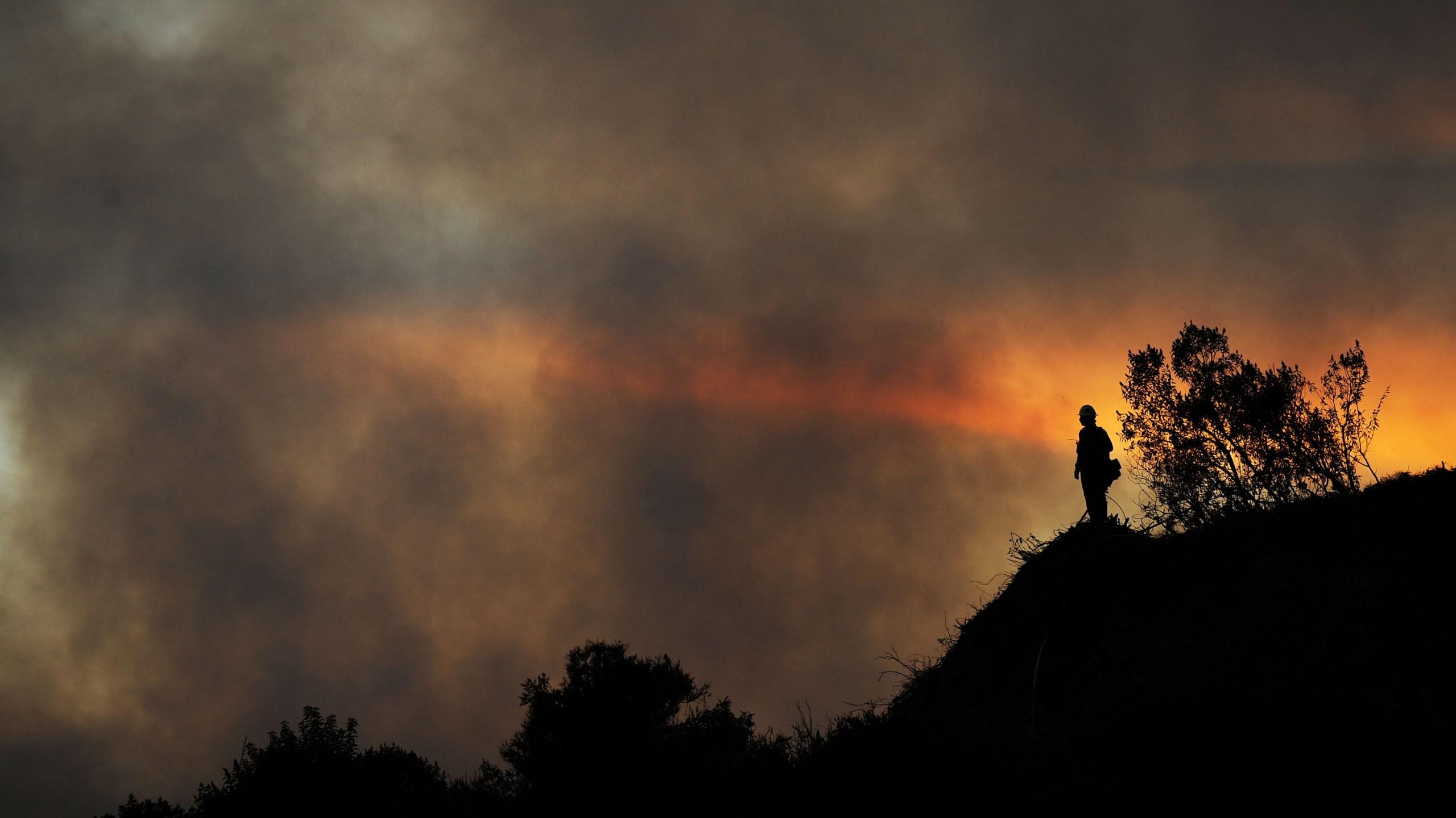 U.S. Forest Service firefighters battle the Angeles Crest Station Fire along the Angeles Crest Highway in La Canada Flintridge on August 28, 2009 in Los Angeles, California. (Credit: Kevork Djansezian/Getty Images)