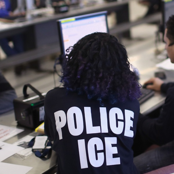 U.S. Immigration and Customs Enforcement officers process detained immigrants on April 11, 2018, at the U.S. Federal Building in New York City. (Credit: John Moore/Getty Images)