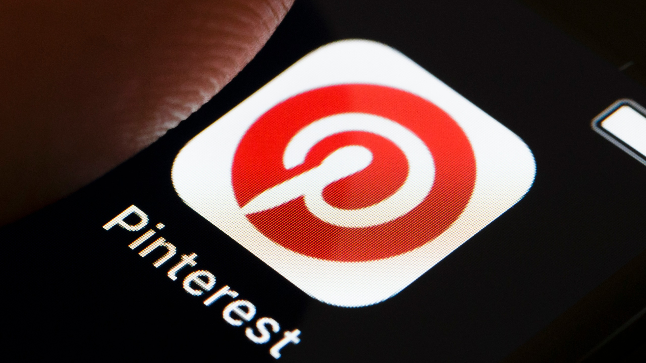 A photo illustration shows the PInterest app icon on a smartphone. (Credit: Thomas Trutschel/Photothek via Getty Images)