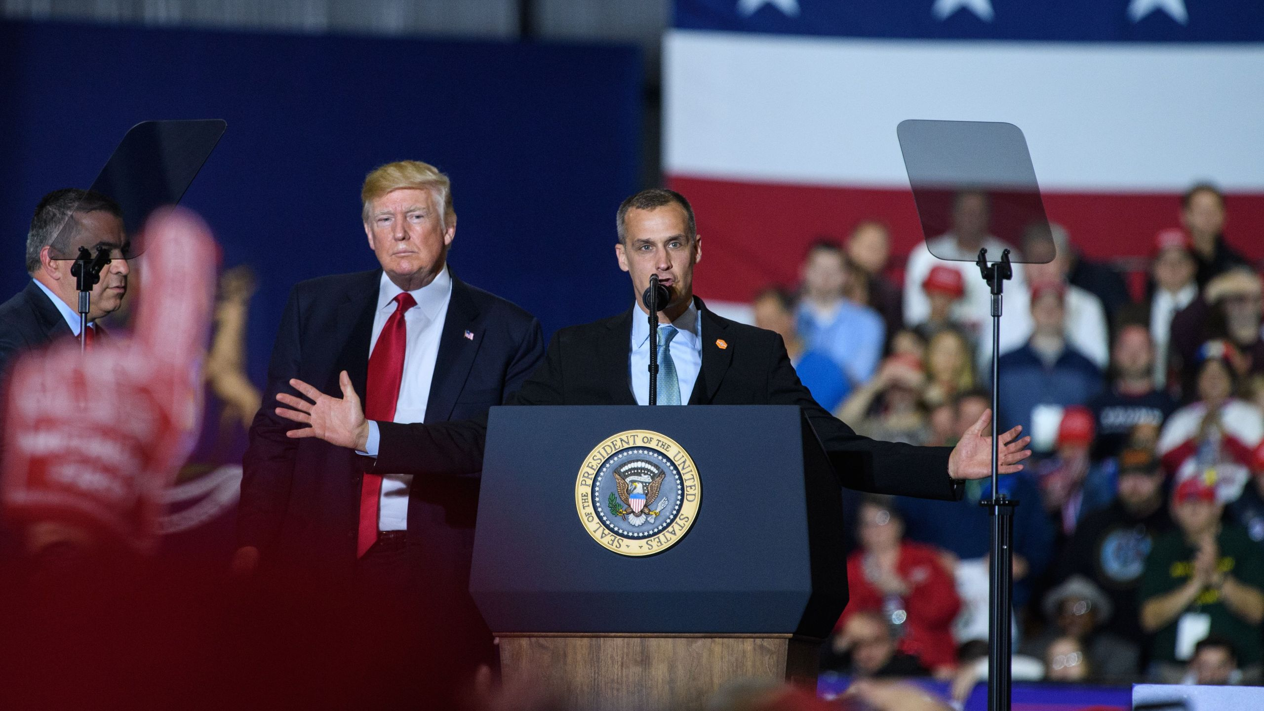 Former Trump Campaign manager Corey Lewandowski speaks as Donald Trump looks on during a rally at Total Sports Park in Washington, Michigan on April 28, 2018. (Credit: MANDEL NGAN/AFP/Getty Images)