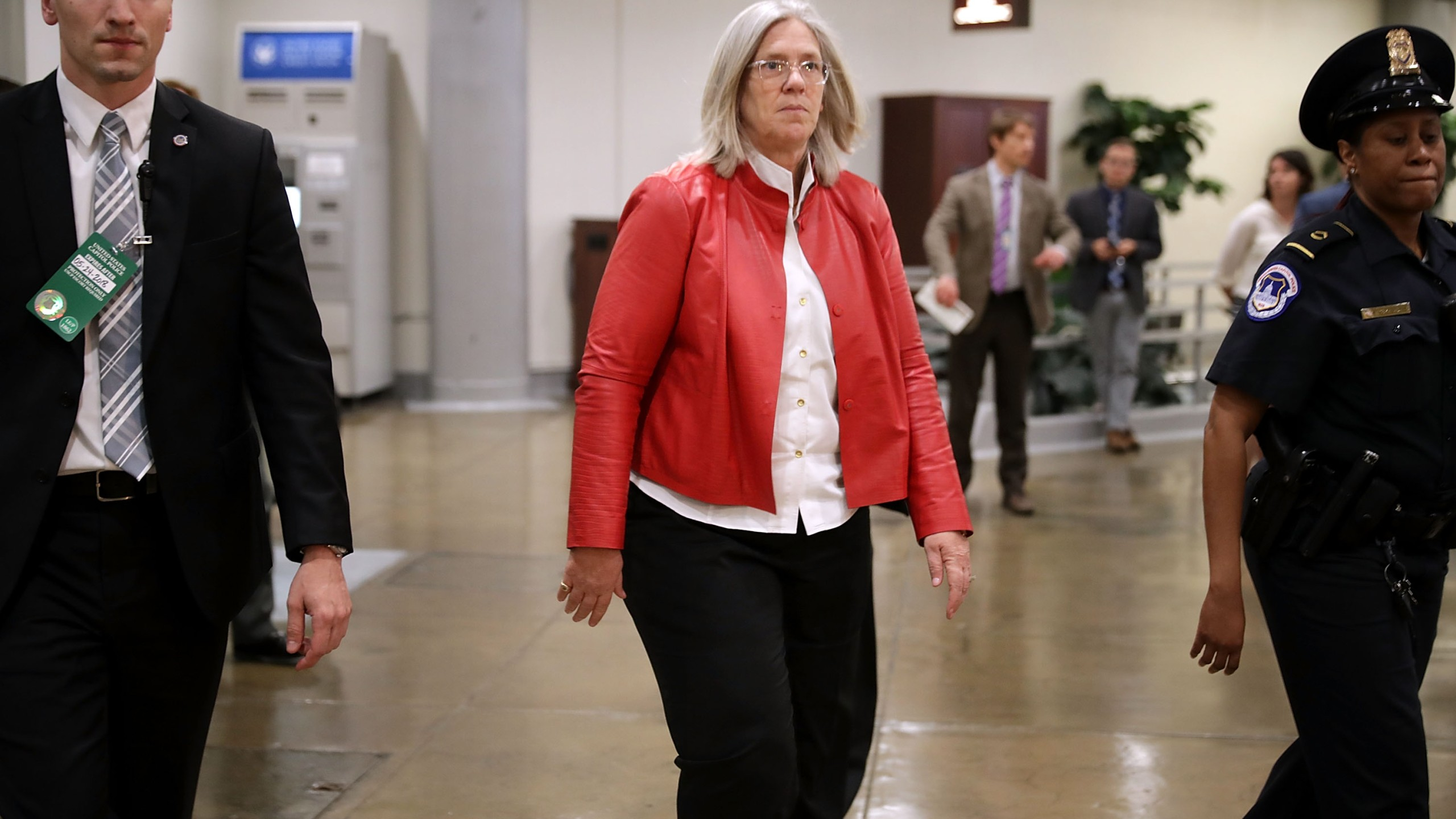 "Principal Deputy Director of National Intelligence Sue Gordon (center) arrives to brief members of the so-called ""Gang of Eight"" at the U.S. Capitol May 24, 2018. (Credit: Chip Somodevilla/Getty Images)"