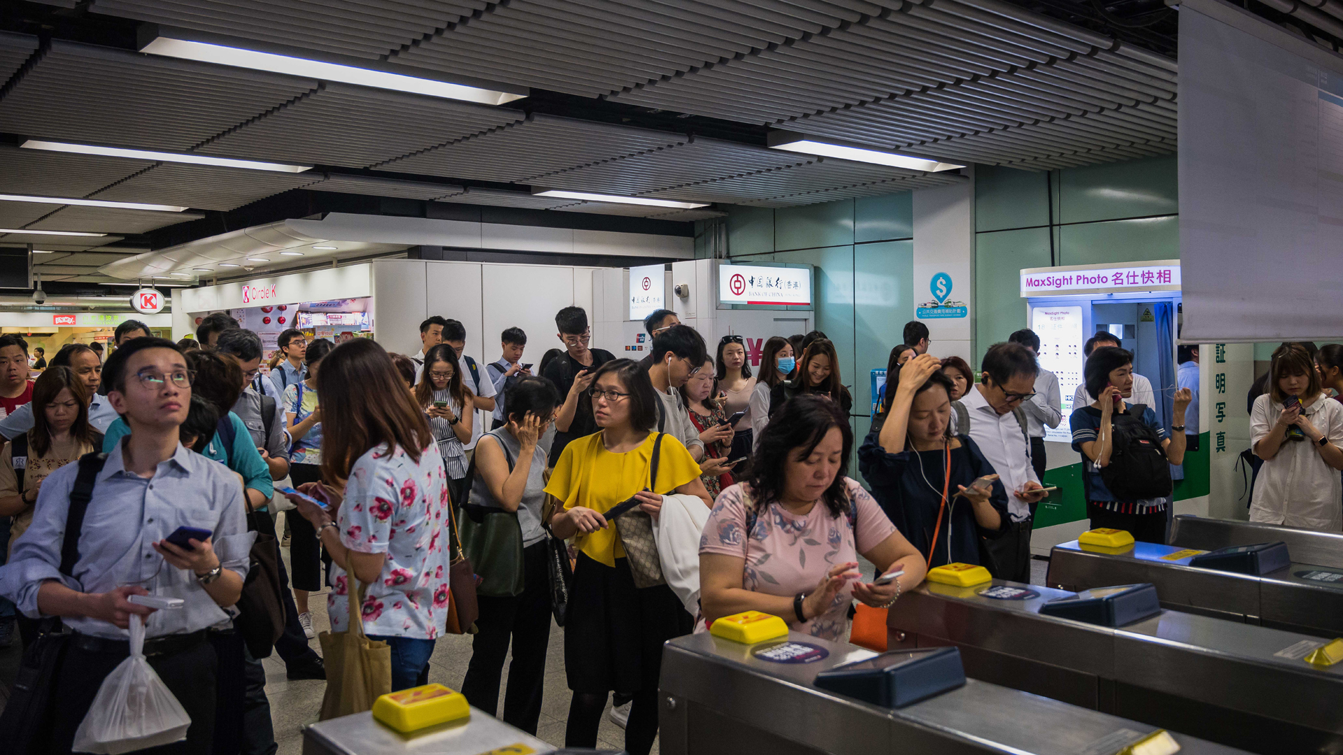 Commuters stand outside the MTR station as a group of protestor protest on August 05, 2019 in Hong Kong, China. (Credit: Billy H.C. Kwok/Getty Images)