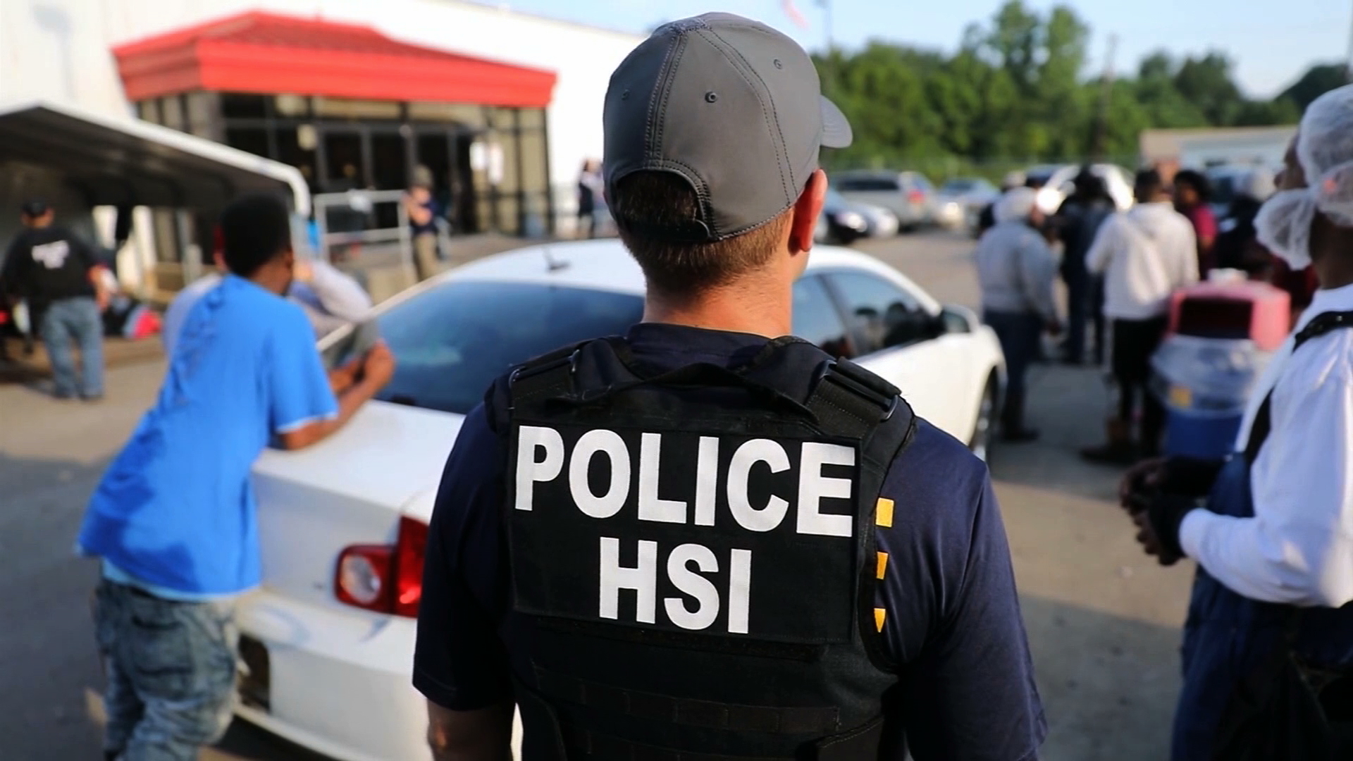 Immigration agents execute a search warrant at a processing plants plant in Mississippi as part of a series of raids in the state on Aug. 7, 2019, in an image released by the agency.