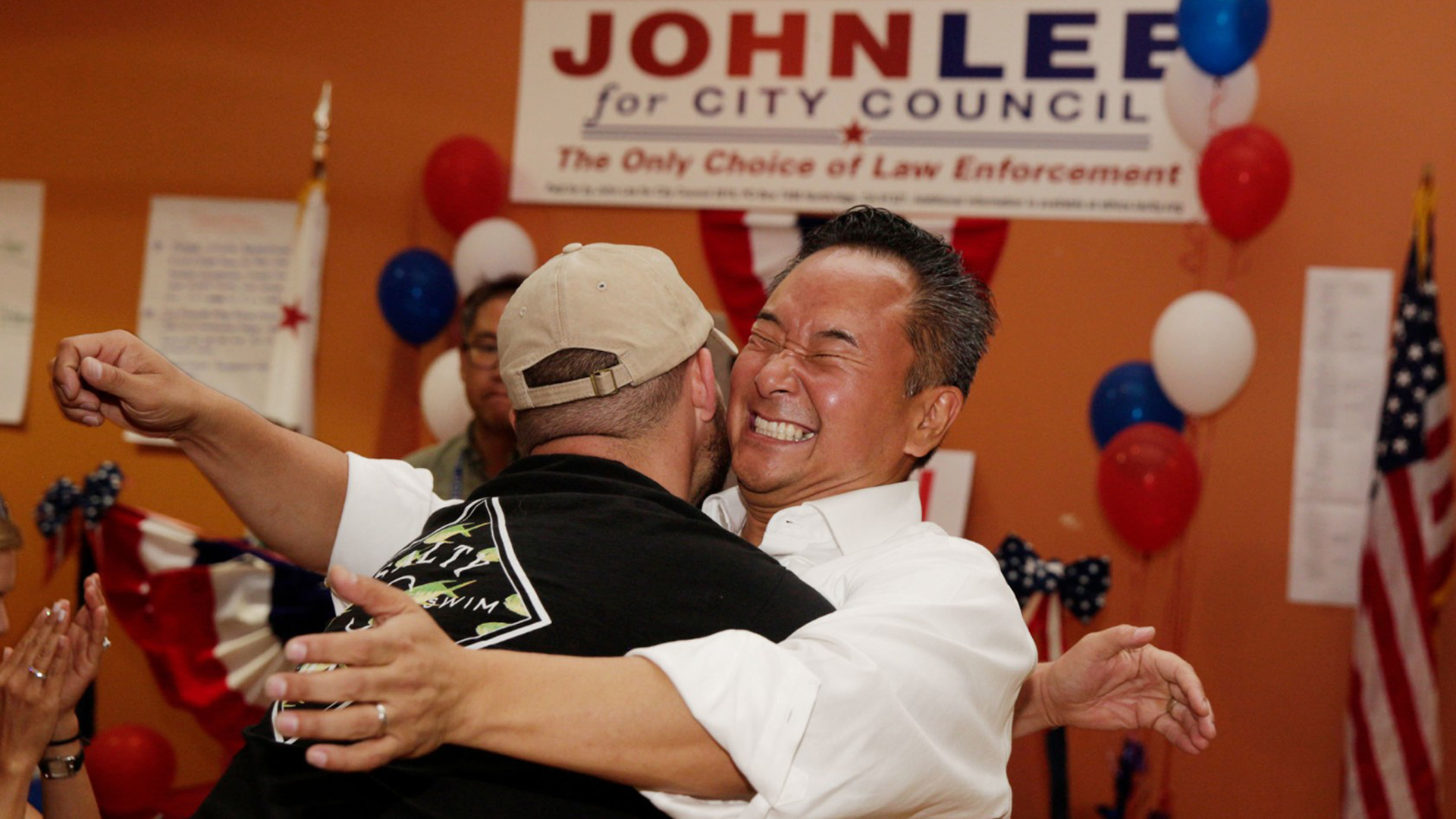 Newly elected councilman John Lee hugs a longtime friend during his election night party. (Credit: Liz Moughon / Los Angeles Times)