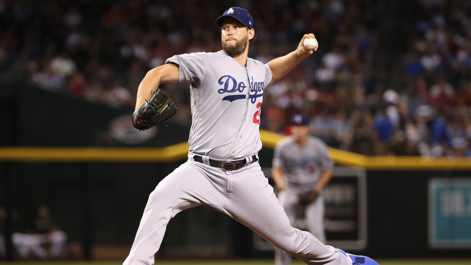 Starting pitcher Clayton Kershaw #22 of the Los Angeles Dodgers pitches against the Arizona Diamondbacks during the first inning of the MLB game at Chase Field on August 31, 2019 in Phoenix, Arizona. (Credit: Christian Petersen/Getty Images)