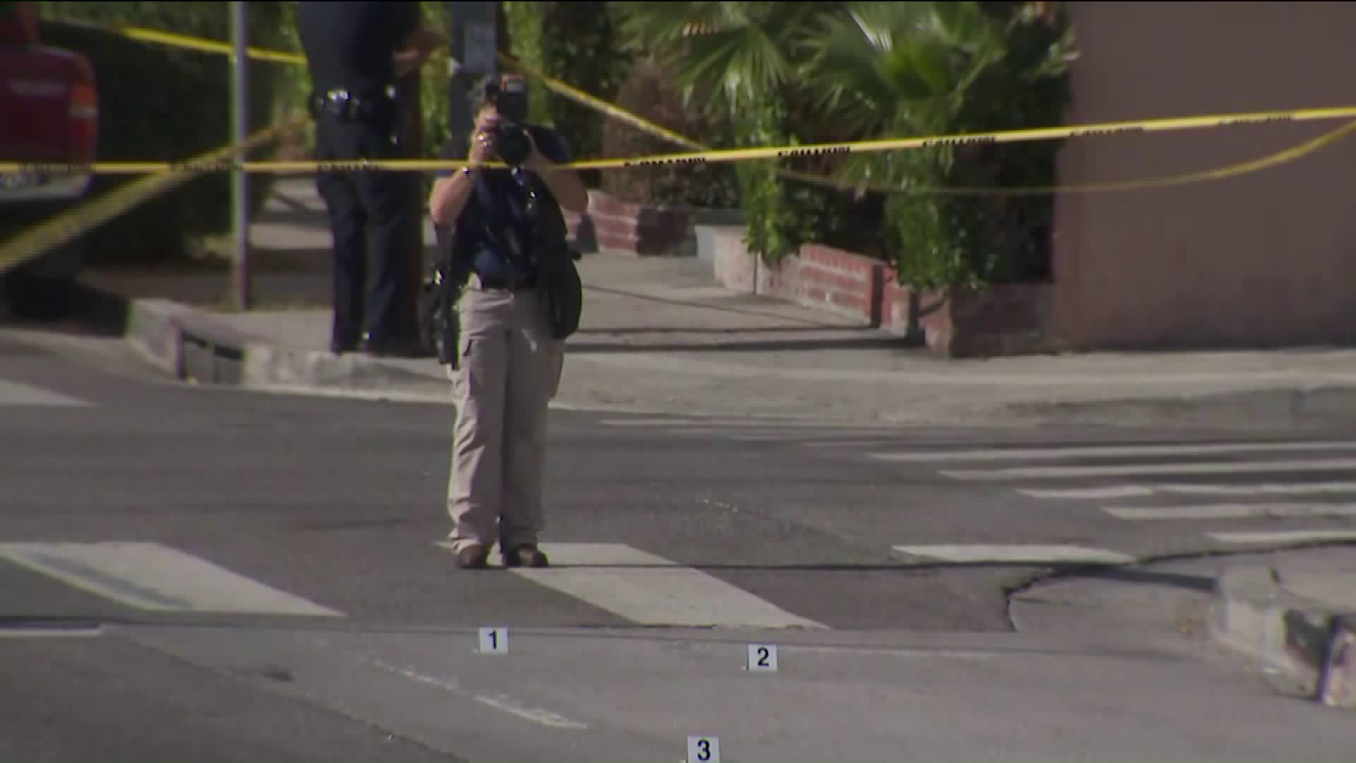 Officials investigate the scene of a shooting that left two people wounded in Los Angeles' Pico-Union neighborhood on Aug. 6, 2019. (Credit: KTLA)