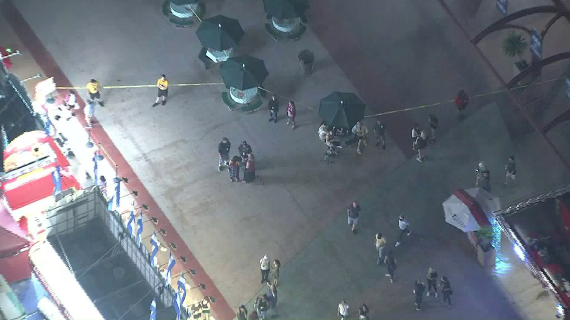 Security personnel and clusters of fairgoers gather around the scene of a fight at the Orange County Fair on July 31, 2019. (Credit: Sky5)