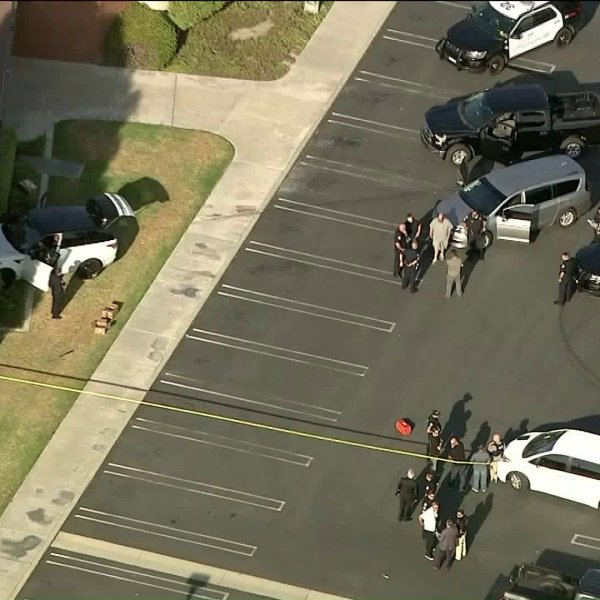 Authorities investigate the scene of a police shooting in Westminster on Aug. 22, 2019. (Credit: KTLA)