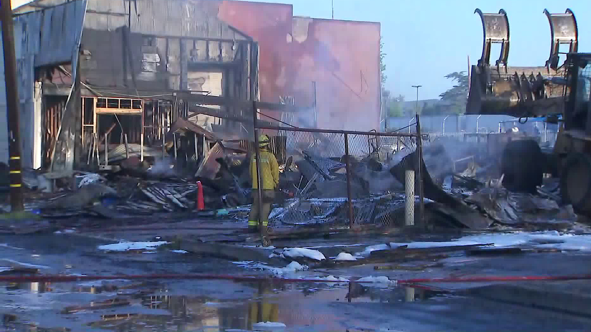 Crews look for hot spots following commercial building blaze in Ontario on Aug. 16, 2019. (Credit: KTLA)