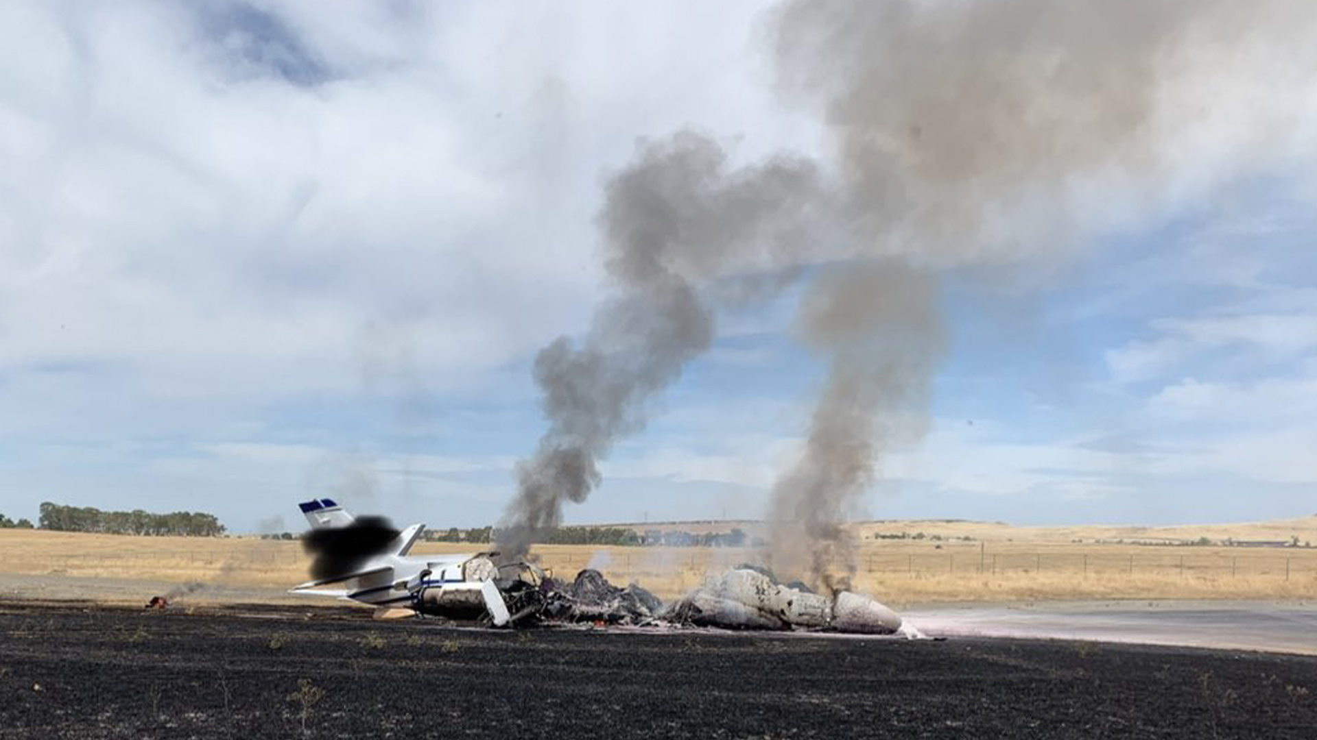 The scene where a jet burst into flames after aborting a takeoff in Oroville on Aug. 21, 2019, is seen in a photo released by the California Highway Patrol.