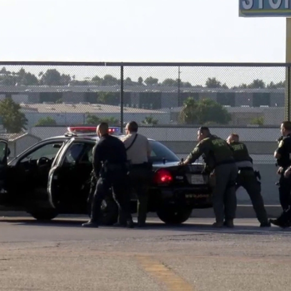 Authorities respond Aug. 12, 2019, to a Riverside gun battle that left one CHP officer dead and two others wounded; the gunman was also killed. (Credit: OC Hawk)