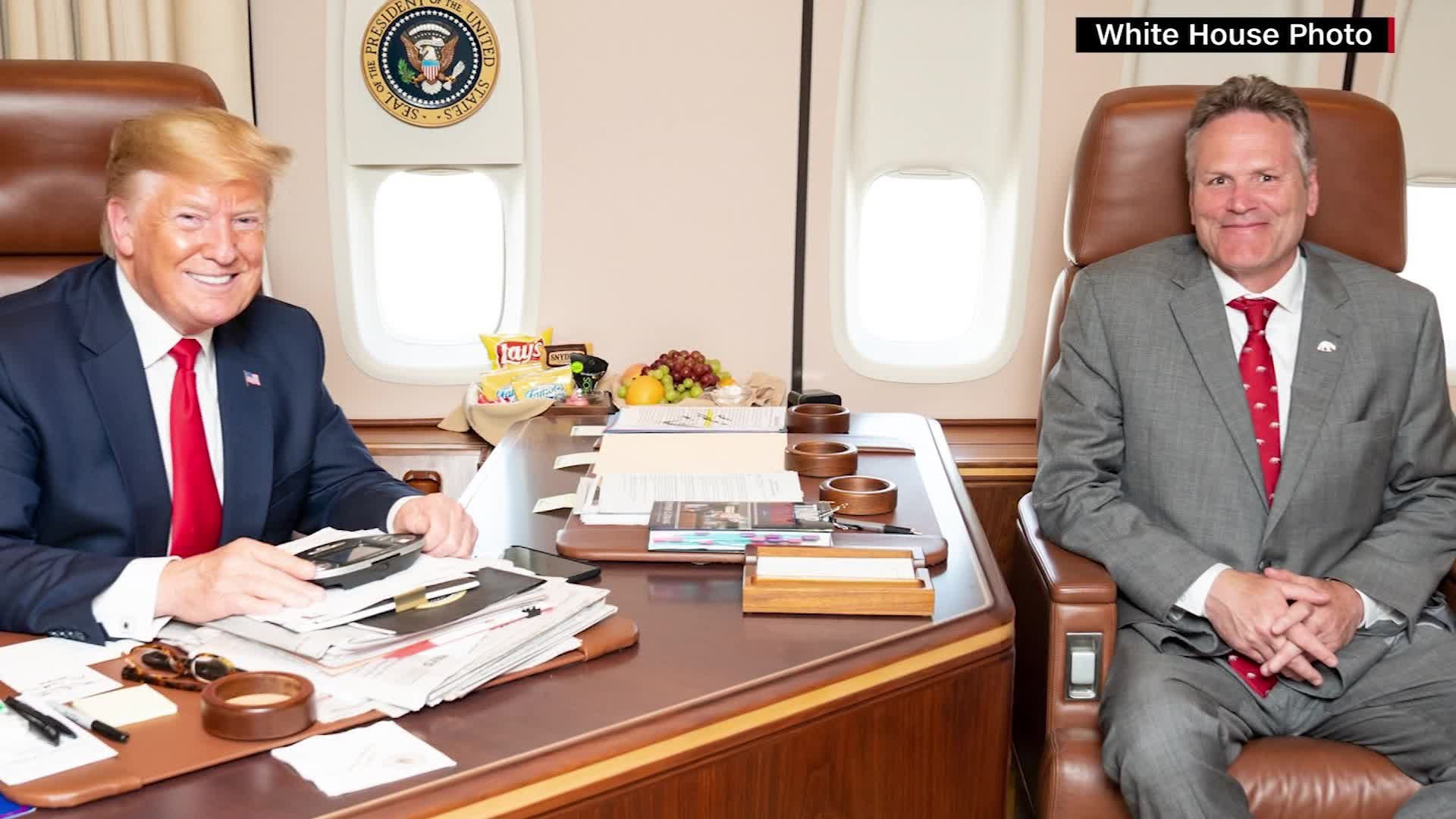 Alaska Gov. Mike Dunleavy met with President Trump aboard Air Force One on June 26, in this photo obtained by CNN.