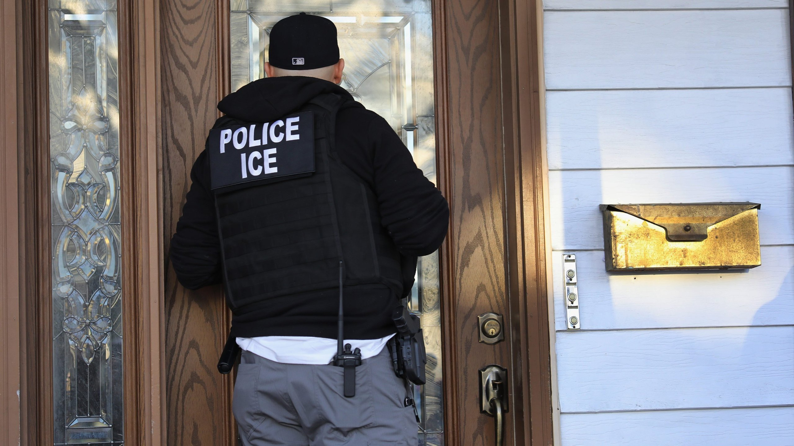 An ICE officer is seen in an undated photo. (Credit: John Moore/Getty Images via CNN)