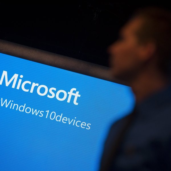 A screen displays Microsoft's logo. (Credit: John Taggart/Bloomberg/Getty via CNN)