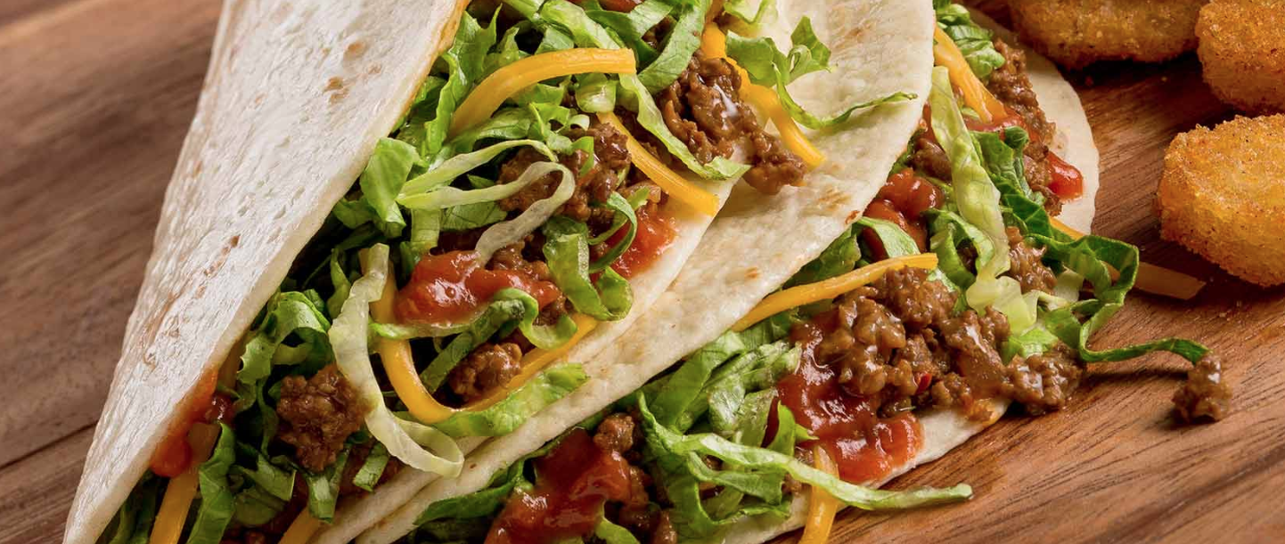"The ""softshell tacos"" from Taco John's are shown in a photo from the chain's website."