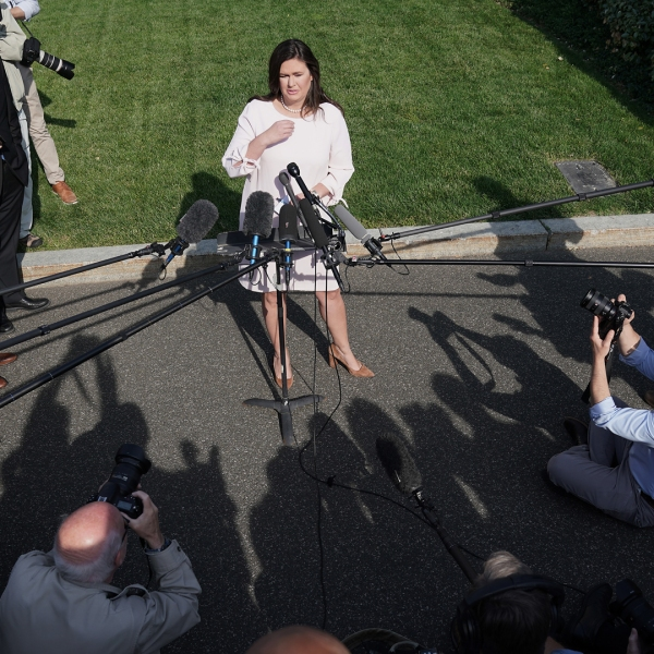 White House Press Secretary Sarah Sanders talks to reporters after an interview with FOX News outside the West Wing on May 23, 2019. (Credit: Chip Somodevilla/Getty Images)