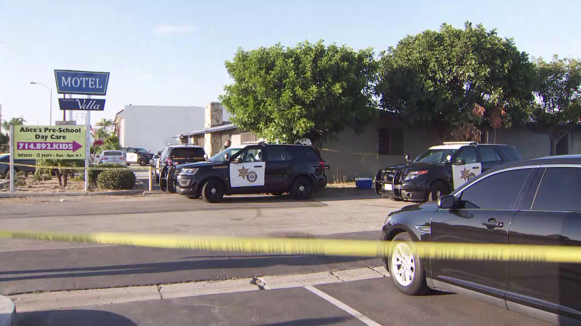 Officials respond to investigate a fatal shooting at a motel in Stanton on Aug. 26, 2019. (Credit: KTLA)