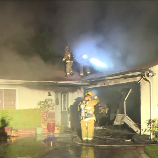 Firefighters work a house fire in Sunland on Aug. 7, 2019 (Credit: RMG News)