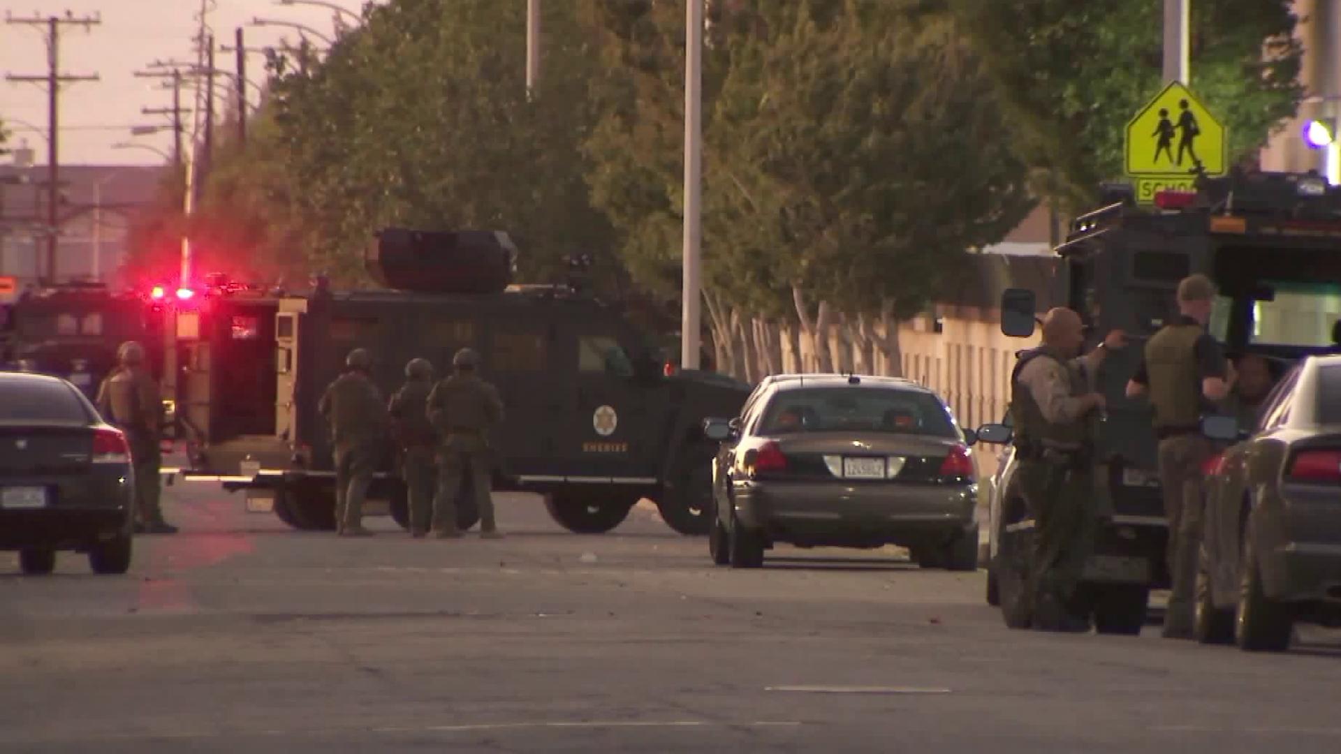 SWAT teams responded to Lancaster after a shooting left a deputy injured in Lancaster on Aug. 21, 2019. (Credit: KTLA)