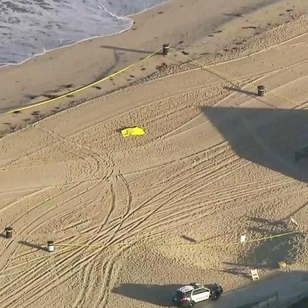 Crime scene tape is seen on a beach in Torrance on Aug. 30, 2019. (Credit: KTLA)