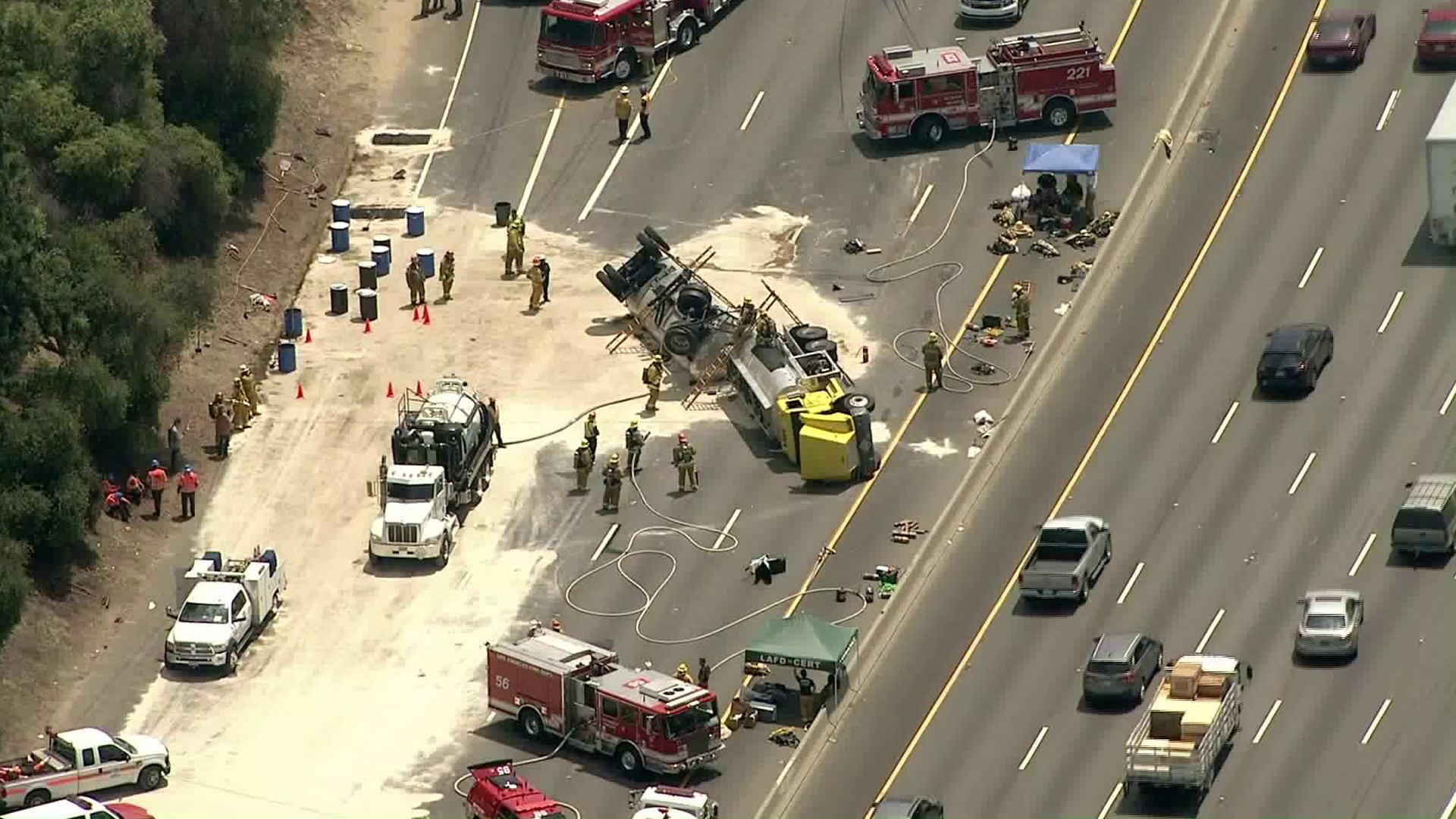 Crews clean up after a fuel tanker overturned on the 5 Freeway near Griffith Park on Aug. 7, 2019. (Credit: Sky5)