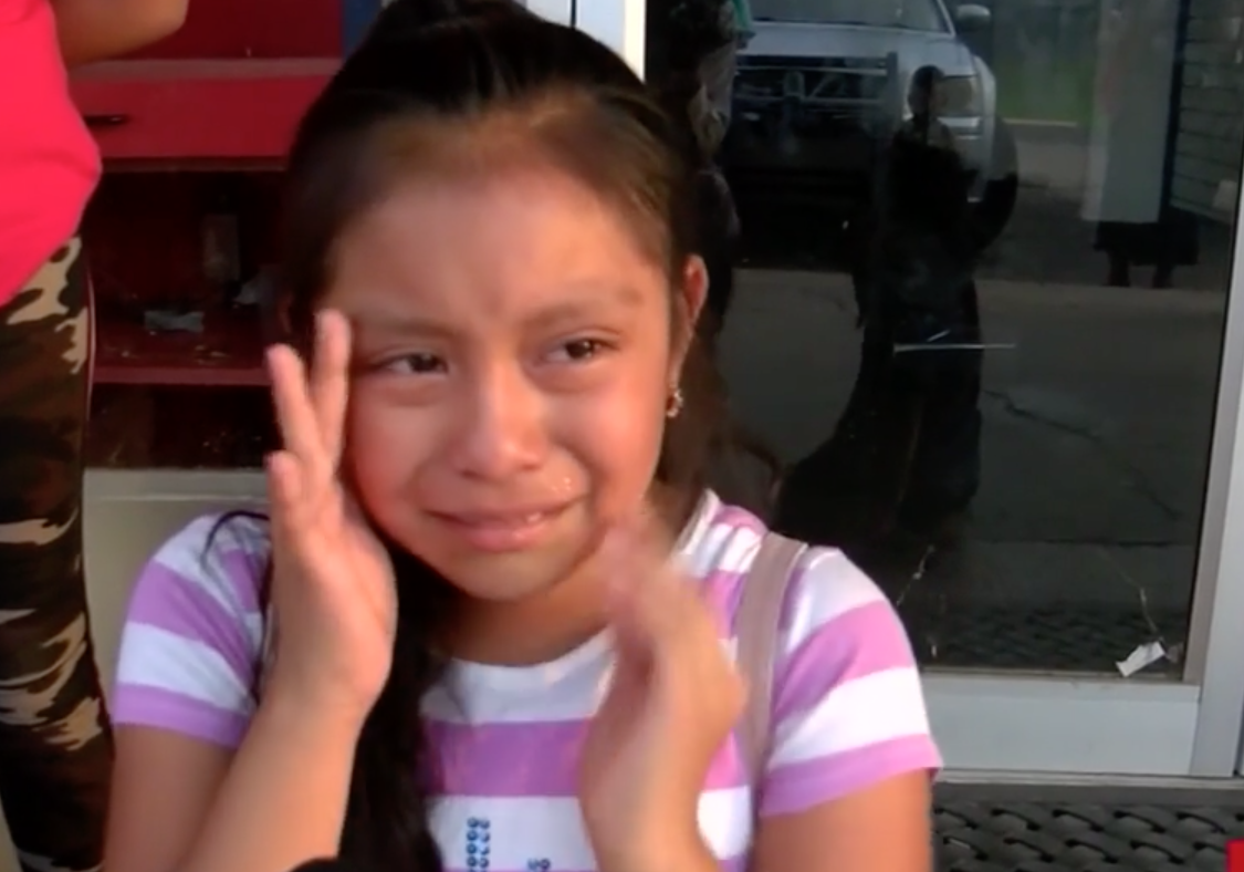 Magdalena Gomez Gregorio cries for her father following immigration raids at Mississippi plants in August 2019. (Credit: WJTV via CNN)
