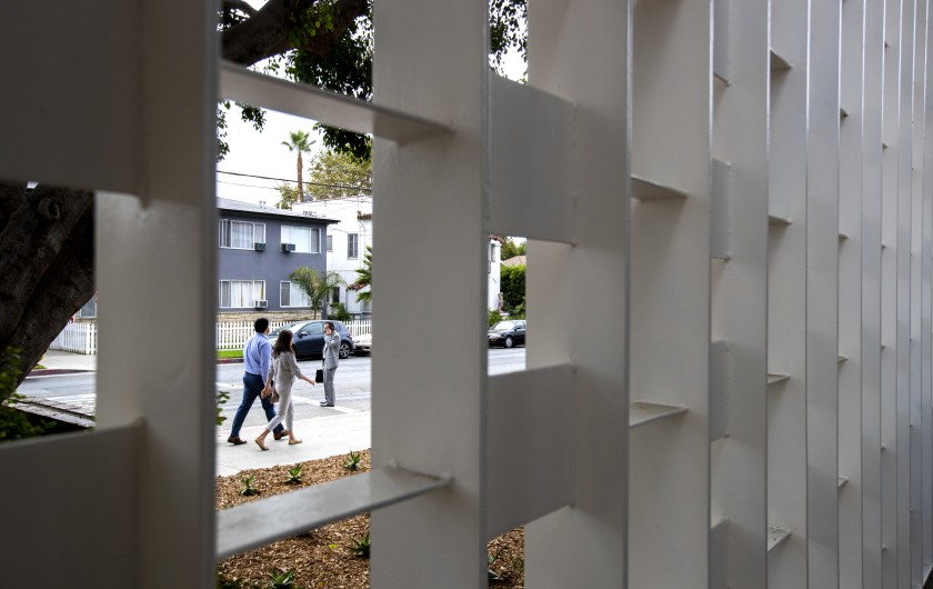 A noise-shielding metal screen on the facade of the 1959 Midcentury Modern Gardner Street library, which has been repurposed as the Gardner Library Women's Bridge Shelter in Hollywood, is seen on Sept. 10, 2019. (Brian van der Brug/Los Angeles Times)