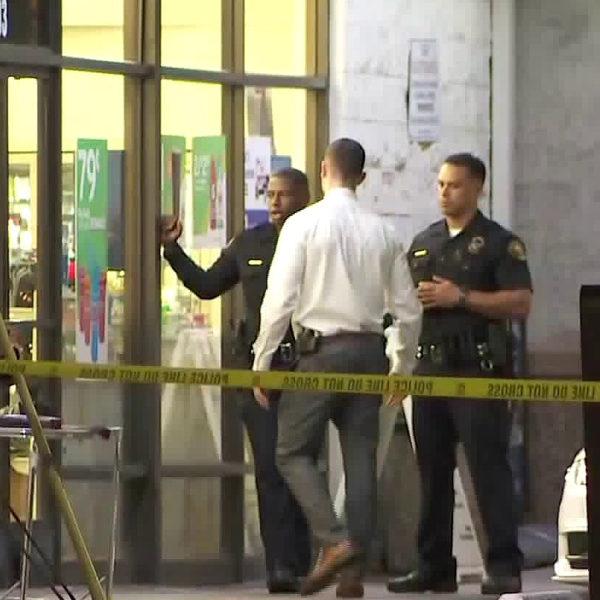 An armed robbery suspect was fatally shot by police in Long Beach on Sept. 20, 2019. (Credit: KTLA)